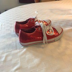 Gotta Flurt red sequin sneakers.